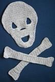 Crocheted Skull and Crossbones poster