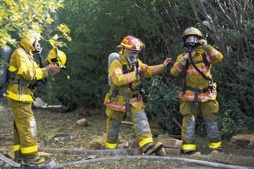 Firemen Putting On Equipment