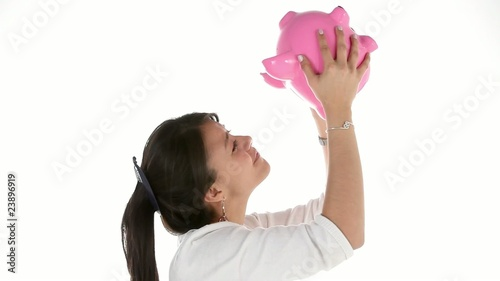 Woman shaking her piggybank