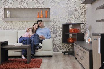 couple relax at home on sofa in living room