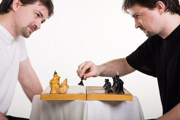 Two men play a chess