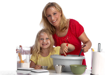 Happy blond mother and daughter baking