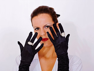 Girl with black satin gloves and rings