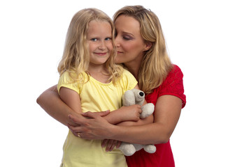 Happy blond mother and daughter hugging