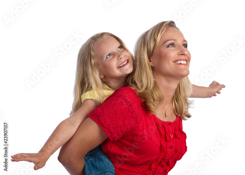 Happy blond mother and daughter