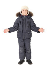little boy in winter dress standing on white background