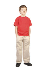 little boy in red shirt hands in pockets standing on white