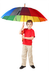 little boy in red shirt with big multicolored umbrella standing