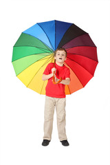 little boy in red shirt opened mouth with multicolored umbrella
