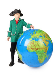 little boy in historical dress standing with inflatable globe