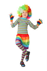 little boy in clown dress standing on one leg isolated on white
