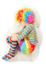 boy in clown dress sleeping view frome above isolated on white