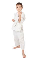 karateka boy in white kimono standing isolated on white