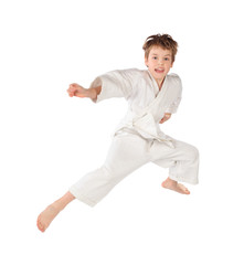 karateka boy in white kimono jumping isolated on white