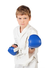 little boxer boy in white dress and blue boxing gloves fighting
