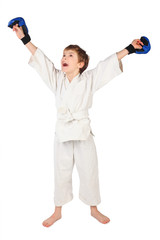 little boxer boy in white dress and blue boxing gloves hands up