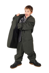 little boy in big grey man's suit and boots hand in pocket