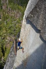 Climber ascending a difficult crack.