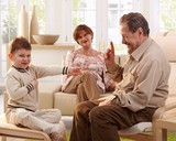 Grandfather telling telling a story to grandson poster