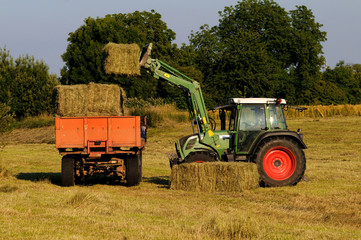 tractor loading hay bay bale