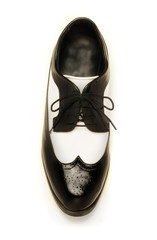 Two-tone black and white patent leather men's shoe