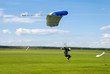 Landing of the sportsman after parachute jump - 23919551