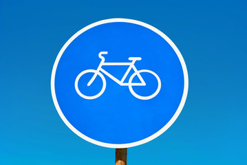 Bicycle path sign isolated on blue sky.