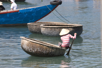 Vietnamese fisherman and his boat