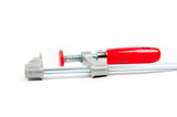 Metal vice with red handle on white background poster