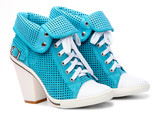 Pair of high-heeled turquoise female shoes