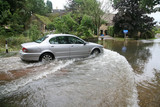Car driving through flood waters - 23937976