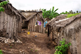 Dusty street of poor african village poster