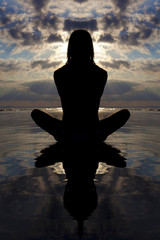 Silhoutte seated yoga pose.