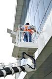 Window washer on a hydraulic ramp