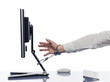Hand chained to computer with handcuffs