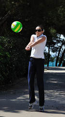 Young female play volleyball