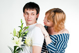 Beautiful young couple with white lilies