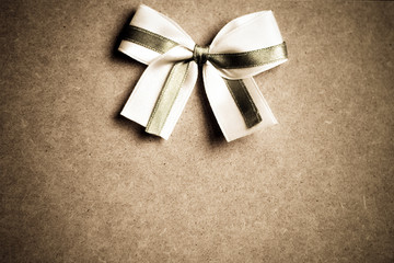 Bow on a wooden background