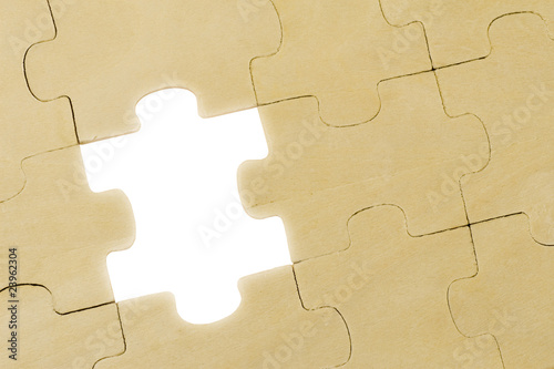 wooden puzzle background with one piece missing