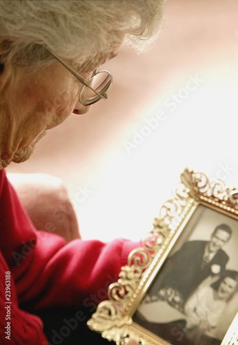 Woman Holds A Photo