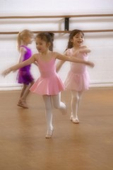Little Girls Practice At Ballet Class