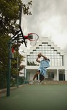 Man Plays Basketball