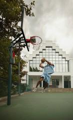 Man Plays Basketball