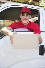 delivery courier in van delivering package