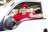 postal delivery courier in a van showing thumb up hand sign
