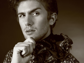 Beautiful man in exclusive design clothes on manners old-slavic