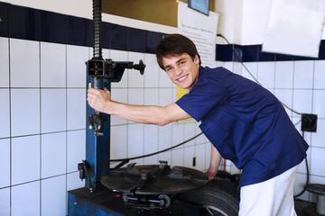 portrait of a car repairing a tire