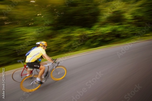 Two People Racing On Bikes