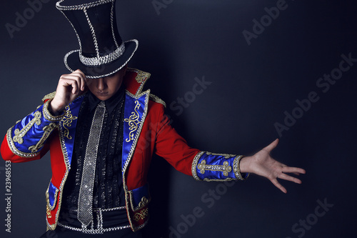 Man in expensive suit of illusionist-conjurer.