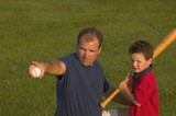 Father And Son Play Baseball